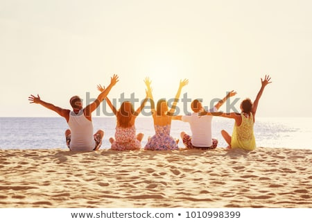 happy family of five having fun by raising hands stock photo © get4net