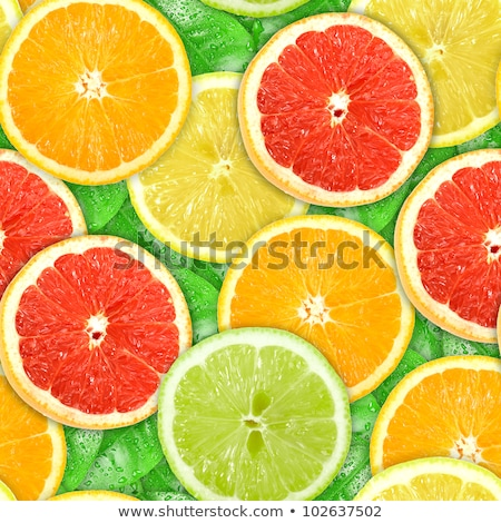 Background with motley citrus slices and green leaf Stock photo © boroda