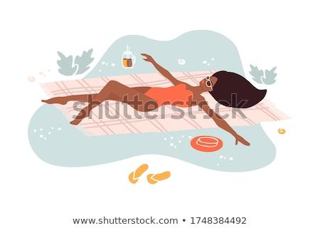 Girls lying on the beach Stock photo © photography33
