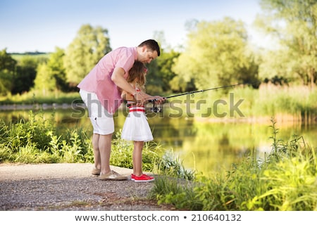 Father and daughter with a fishing net Stock photo © photography33