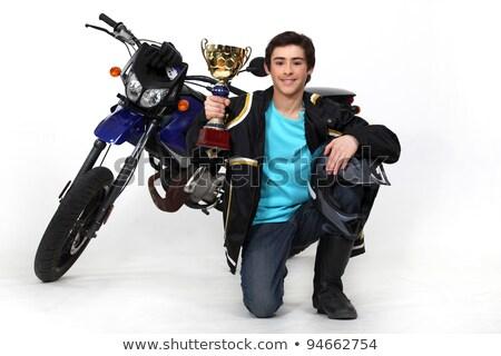 Nastolatek złota kubek motocykl niebieski dżinsy Zdjęcia stock © photography33