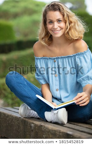 Blond woman sat on bench Stock photo © photography33