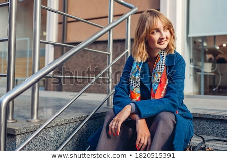 portrait of sitting young woman wearing extravagant clothes Stock photo © phbcz