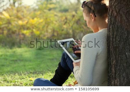 Lány park táblagép napos idő Stock fotó © imarin