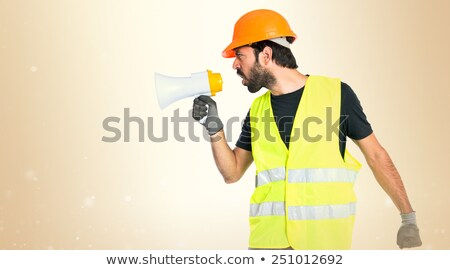 Builder shouting into megaphone Stock photo © photography33