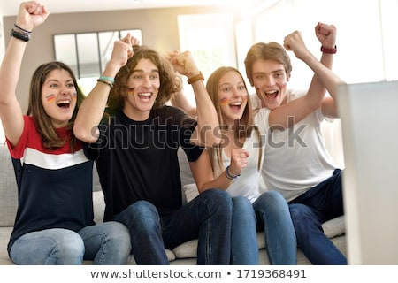 Four young adults supporting the French soccer team Stock photo © photography33