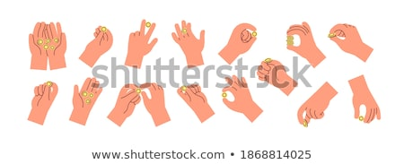 Man's arm and hand tossing golden coin Stock photo © backyardproductions