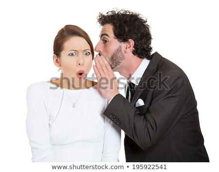 Man whispering a woman something funny Stock photo © wavebreak_media