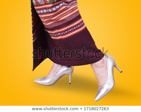 Woman wearing traditional Asian dress and high heels stock photo © wavebreak_media
