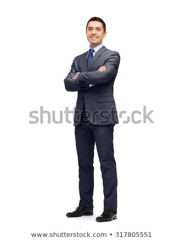 sonriendo · hombre · traje · armas · camisa · camarero - foto stock © wavebreak_media