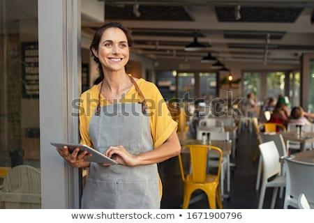Sonriendo mujer de negocios digital tableta jóvenes Foto stock © wavebreak_media
