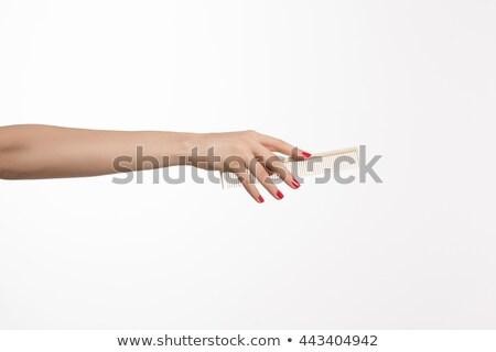 Kéz tart fogantyú gereblye kék izolált Stock fotó © timbrk