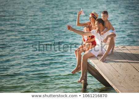 Famille rive mer ciel fille amour Photo stock © koca777