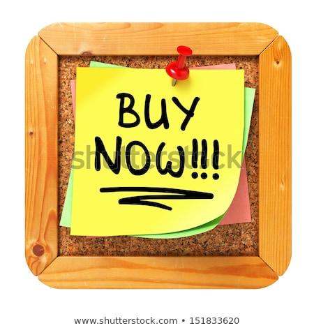 Buy Now!!!. Yellow Sticker on Bulletin. Stock photo © tashatuvango