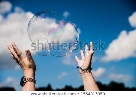 mulher · bolha · de · sabão · mulher · jovem · bolhas · de · sabão · verão - foto stock © choreograph