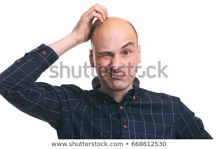 young fashion man scrathes his head stock photo © feedough