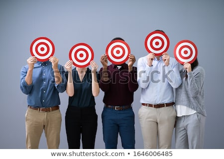 group of businesspeople aiming at target stock photo © kirill_m