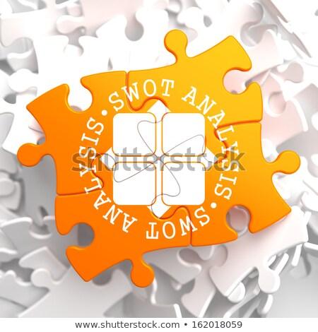 swot analisis on orange puzzle stock photo © tashatuvango