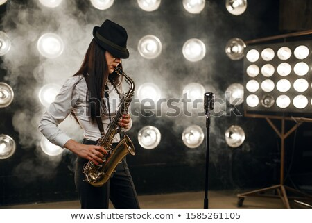 Attractive woman with saxophone Stock photo © Aikon