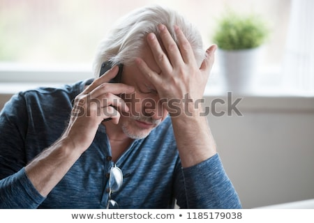 old man having trouble hearing Stock photo © ichiosea