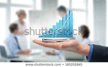 On the palm of the hand is a growth graph Stock photo © cherezoff