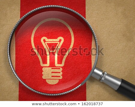 Helpful Tips. Magnifying Glass on Old Paper. Stock photo © tashatuvango