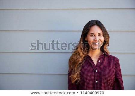 Young Hispanic woman outside home Stock photo © monkey_business