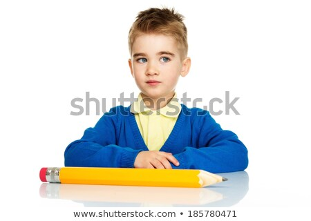 Little preschool boy in blue cardigan and yellow shirt with big pencil  Stock photo © Nejron