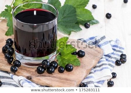 Negro grosella jugo hoja vidrio jardín Foto stock © yelenayemchuk