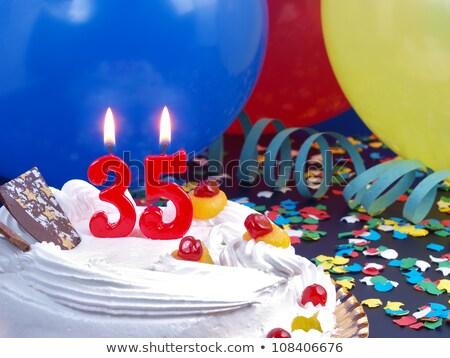 Birthday cake with burning candle number 35 Stock photo © Zerbor