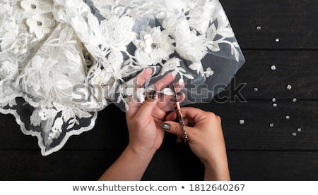sewer with fabrics and fashion clothes holding scissors stock photo © feelphotoart