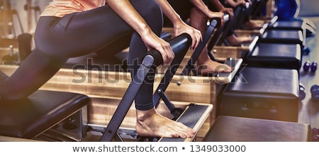 Pilates entraînement femmes gymnase fille Photo stock © lunamarina