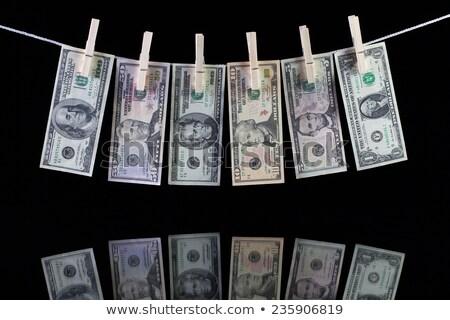 Koszos dollár bankjegyek akasztás ruhaszárító kéz Stock fotó © CaptureLight