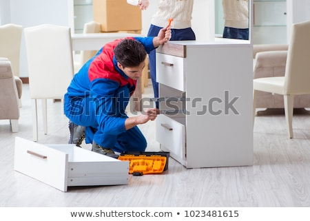 Woman Assembling Furniture Stock photo © HASLOO