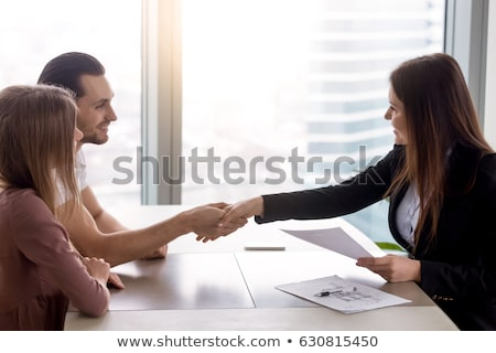 ストックフォト: Business Man Offering Home Or Office For Rent