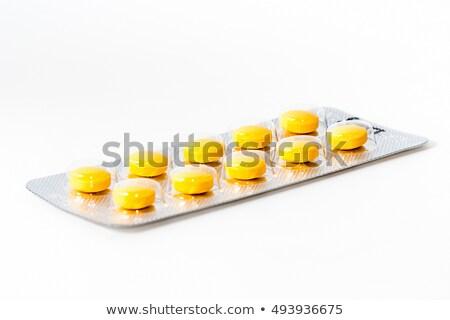 Blister pack of Yellow medicine pills Close up Stock photo © gemenacom