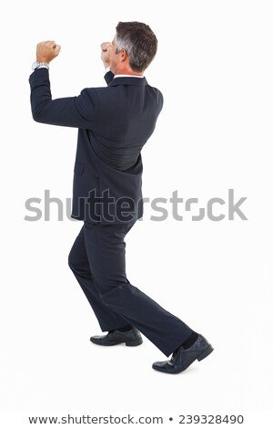 Businessman in suit pushing with his fists Stock photo © wavebreak_media