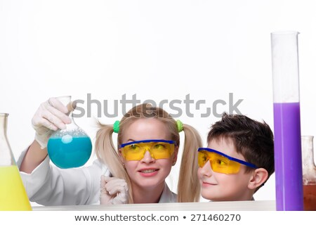 Teen and teacher of chemistry at  lesson making experiments Stock photo © master1305