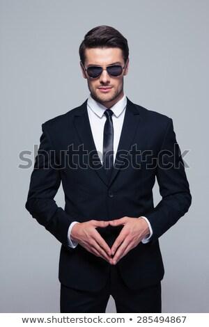 トレンディー 小さな ビジネスマン サングラス 見える カメラ ストックフォト © deandrobot
