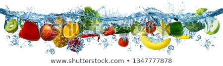 fresh apples falling into water with splashes stock photo © zerbor