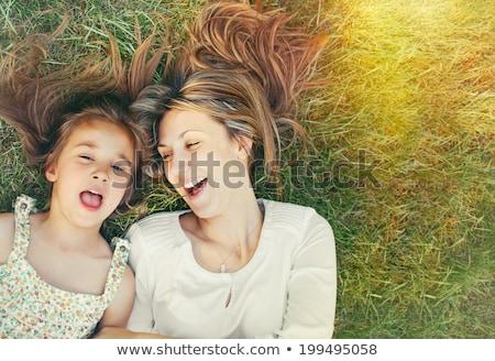 nő · fiatal · lány · kint · átkarol · nevet · fű - stock fotó © nenetus