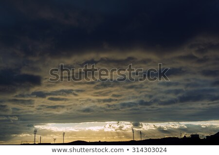 Fluffy cloudscape over Tenerife at sunset Stock photo © amok