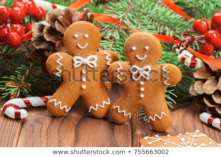 Gingerbread man on a wooden background Stock photo © Zerbor