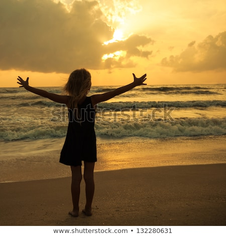 Happy family with little girl standing on beach in evening stock photo © Paha_L