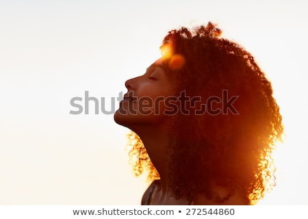 Beauty portrait of curly relaxed young woman with eyes closed Stock photo © deandrobot