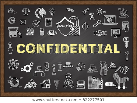 Confidential Data - Chalkboard with Hand Drawn Text. Stock photo © tashatuvango