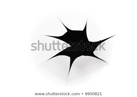 Stock photo: the sheet of paper with the group of holes against the black background