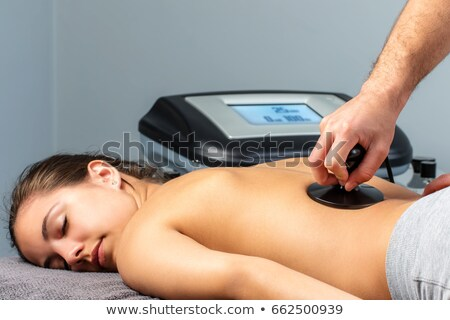 Woman having electrotherapy stock photo © wavebreak_media