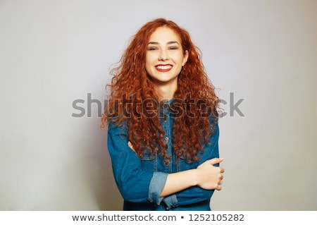Portait of a smiling cute redhead woman stock photo © deandrobot
