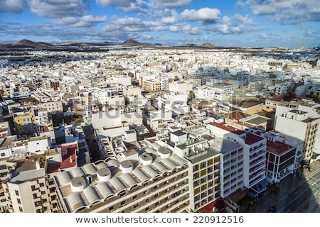 aerial view to Arrecife with volcanoes in the background Stock photo © meinzahn